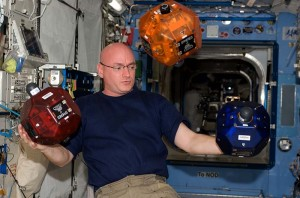 Astronaut Kelly plays with SPHERES (Courtesy of NASA)
