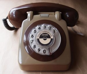 An antique dial-up telephone, desktop style, in beige